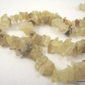 Shop Rutilated Quartz Chip & Nugget Beads! 8mm – 9mm Natural Golden Rutilated Quartz Chip Bead Strand, 16 Inch Whole strand Yellow Quartz Chip Beads | Natural genuine chip Rutilated Quartz beads for beading and jewelry making.  #jewelry #beads #beadedjewelry #diyjewelry #jewelrymaking #beadstore #beading #affiliate #ad