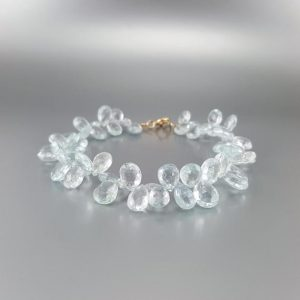 Shop Aquamarine Bracelets! Sparkling drops of Aquamarine bracelet with 14K gold clasp – gift idea – faceted natural gemstone – light blue – elegant and playful -bridal | Natural genuine Aquamarine bracelets. Buy handcrafted artisan wedding jewelry.  Unique handmade bridal jewelry gift ideas. #jewelry #beadedbracelets #gift #crystaljewelry #shopping #handmadejewelry #wedding #bridal #bracelets #affiliate #ad