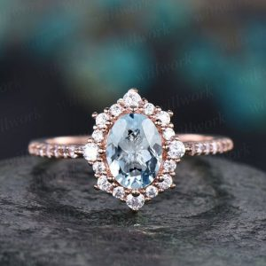 Shop Aquamarine Rings! 6x8mm Blue Aquamarine Engagement Ring Rose Gold Moissanite Halo Ring Oval Aquamarine Ring Gold Vintage For Women Her Wedding Band Jewelry | Natural genuine Aquamarine rings, simple unique alternative gemstone engagement rings. #rings #jewelry #bridal #wedding #jewelryaccessories #engagementrings #weddingideas #affiliate #ad