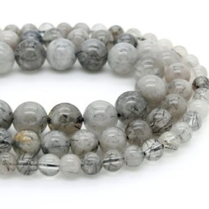 Shop Rutilated Quartz Round Beads! Black Hair Rutilated Quartz Smooth Round Ball Sphere Natural Gemstone Beads – Full Strand | Natural genuine round Rutilated Quartz beads for beading and jewelry making.  #jewelry #beads #beadedjewelry #diyjewelry #jewelrymaking #beadstore #beading #affiliate #ad