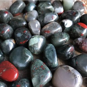 Shop Tumbled Bloodstone Crystals & Pocket Stones! African Bloodstone Crystals | Natural genuine stones & crystals in various shapes & sizes. Buy raw cut, tumbled, or polished gemstones for making jewelry or crystal healing energy vibration raising reiki stones. #crystals #gemstones #crystalhealing #crystalsandgemstones #energyhealing #affiliate #ad
