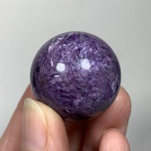 Shop Charoite Stones & Crystals! 31mm CHAROITE SPHERE – Natural Crystal Ball – Genuine Polished Stone – Healing Crystal – Meditation Stone – Display – Gift- From Russia- 40g | Natural genuine stones & crystals in various shapes & sizes. Buy raw cut, tumbled, or polished gemstones for making jewelry or crystal healing energy vibration raising reiki stones. #crystals #gemstones #crystalhealing #crystalsandgemstones #energyhealing #affiliate #ad