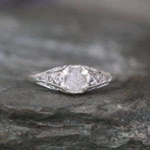 Shop Healing Gemstone Rings! Antique Style Raw Diamond Engagement Ring – Rough Uncut Rough Diamond Gemstone and Sterling Silver Filigree Ring  – April Birthstone | Natural genuine Gemstone rings, simple unique alternative gemstone engagement rings. #rings #jewelry #bridal #wedding #jewelryaccessories #engagementrings #weddingideas #affiliate #ad