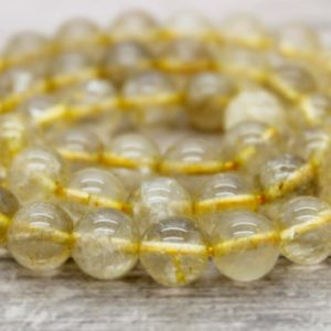 Golden Rutilated Quartz Round Beads Natural Stone Gemstone (8mm 10mm 12mm) | Natural genuine round Rutilated Quartz beads for beading and jewelry making.  #jewelry #beads #beadedjewelry #diyjewelry #jewelrymaking #beadstore #beading #affiliate #ad