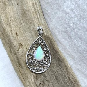 Shop Opal Pendants! 14 Kt White Gold Pear Shaped Natural Opal (0.63 Ct) Pendant, Appraised 1, 025 Cad | Natural genuine Opal pendants. Buy crystal jewelry, handmade handcrafted artisan jewelry for women.  Unique handmade gift ideas. #jewelry #beadedpendants #beadedjewelry #gift #shopping #handmadejewelry #fashion #style #product #pendants #affiliate #ad
