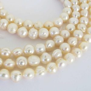 Shop Freshwater Pearls! 6mm Round Potato Pearls, Ivory White Pearls, Freshwater Pearls, Genuine Pearls, Full Strand Freshwater Pearls, 16 Inch Strand, Pearl204 | Natural genuine beads Pearl beads for beading and jewelry making.  #jewelry #beads #beadedjewelry #diyjewelry #jewelrymaking #beadstore #beading #affiliate #ad