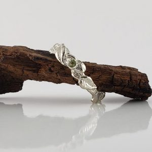 Shop Peridot Rings! The Maddox Ring! Peridot Gemstone Hand Sculpted Leaf Twig and Vine Ring in Sterling Silver by Dawn Vertrees | Natural genuine Peridot rings, simple unique handcrafted gemstone rings. #rings #jewelry #shopping #gift #handmade #fashion #style #affiliate #ad