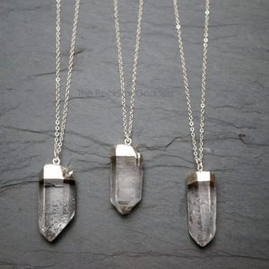 Shop Healing Gemstone & Crystal Pendants! Quartz Necklace / Raw Quartz Necklace / Silver Quartz Pendant / Rough Quartz Necklace / Silver Quartz Jewelry / Natural Quartz Necklace | Natural genuine Gemstone pendants. Buy crystal jewelry, handmade handcrafted artisan jewelry for women.  Unique handmade gift ideas. #jewelry #beadedpendants #beadedjewelry #gift #shopping #handmadejewelry #fashion #style #product #pendants #affiliate #ad