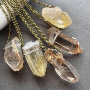 Shop Rutilated Quartz Jewelry! Raw Rutilated Quartz Necklace – Raw Crystal Necklace – Boho Crystal Talisman Necklace – Gold Rutile Quartz Jewelry – Raw Quartz Necklace | Natural genuine Rutilated Quartz jewelry. Buy crystal jewelry, handmade handcrafted artisan jewelry for women.  Unique handmade gift ideas. #jewelry #beadedjewelry #beadedjewelry #gift #shopping #handmadejewelry #fashion #style #product #jewelry #affiliate #ad