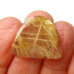 Shop Rutilated Quartz Cabochons! Rutilated Quartz Cabochon Specimen, Brazil, USA cut and polished, Freeform dome shape, 100% transparent, Beautiful  patterns, Fine polish | Natural genuine stones & crystals in various shapes & sizes. Buy raw cut, tumbled, or polished gemstones for making jewelry or crystal healing energy vibration raising reiki stones. #crystals #gemstones #crystalhealing #crystalsandgemstones #energyhealing #affiliate #ad