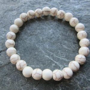 Shop Magnesite Bracelets! The cream magnesite bracelet! Stretch bracelet in natural stones 8mm Reiki infused | Natural genuine Magnesite bracelets. Buy crystal jewelry, handmade handcrafted artisan jewelry for women.  Unique handmade gift ideas. #jewelry #beadedbracelets #beadedjewelry #gift #shopping #handmadejewelry #fashion #style #product #bracelets #affiliate #ad