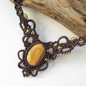 Shop Tiger Eye Jewelry! Micro macrame Tiger eye & Brass necklace, Wide macrame necklace, macrame collar, Oval Tiger eye stone, Natural tiger eye, Tribal boho gypsy | Natural genuine Tiger Eye jewelry. Buy crystal jewelry, handmade handcrafted artisan jewelry for women.  Unique handmade gift ideas. #jewelry #beadedjewelry #beadedjewelry #gift #shopping #handmadejewelry #fashion #style #product #jewelry #affiliate #ad