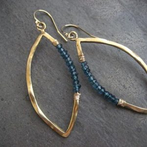 Marquis earrings, blue topaz, blue dangle, marquis hoops, gold earrings, blue topaz rondelle, wire wrapped, blue and gold, handmade, organic | Natural genuine Gemstone jewelry. Buy crystal jewelry, handmade handcrafted artisan jewelry for women.  Unique handmade gift ideas. #jewelry #beadedjewelry #beadedjewelry #gift #shopping #handmadejewelry #fashion #style #product #jewelry #affiliate #ad