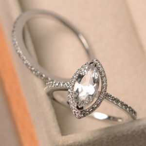 Shop Topaz Engagement Rings! White topaz ring, marquise cut colorless gemstone, sterling silver halo ring, engagement ring with band | Natural genuine Topaz rings, simple unique alternative gemstone engagement rings. #rings #jewelry #bridal #wedding #jewelryaccessories #engagementrings #weddingideas #affiliate #ad