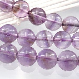 Shop Amethyst Round Beads! Amethyst Phantom Quartz A Grade 9.5-10mm Round Beads (etb01124) | Natural genuine round Amethyst beads for beading and jewelry making.  #jewelry #beads #beadedjewelry #diyjewelry #jewelrymaking #beadstore #beading #affiliate #ad