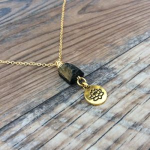 Shop Black Tourmaline Necklaces! Raw Black Tourmaline necklace, lotus charm | Natural genuine Black Tourmaline necklaces. Buy crystal jewelry, handmade handcrafted artisan jewelry for women.  Unique handmade gift ideas. #jewelry #beadednecklaces #beadedjewelry #gift #shopping #handmadejewelry #fashion #style #product #necklaces #affiliate #ad