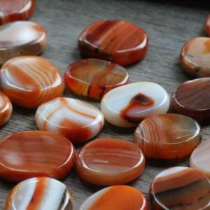 Carnelian Small Flat Disk J116 | Natural genuine stones & crystals in various shapes & sizes. Buy raw cut, tumbled, or polished gemstones for making jewelry or crystal healing energy vibration raising reiki stones. #crystals #gemstones #crystalhealing #crystalsandgemstones #energyhealing #affiliate #ad