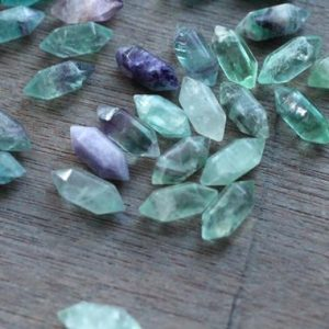 Shop Fluorite Stones & Crystals! Set of 10 Fluorite Small Double Terminated Carved Point M56 | Natural genuine stones & crystals in various shapes & sizes. Buy raw cut, tumbled, or polished gemstones for making jewelry or crystal healing energy vibration raising reiki stones. #crystals #gemstones #crystalhealing #crystalsandgemstones #energyhealing #affiliate #ad