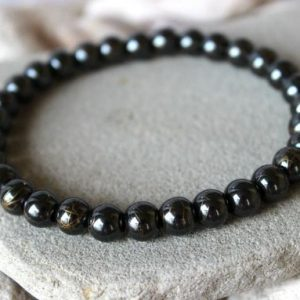 Shop Hematite Bracelets! Hematite Bracelet, 8mm Hematite Bracelet, Hematite Wrist Mala, Grey Bead Bracelet, Hematite Jewelry, Grey Stone Bracelet, 8mm Hematite Beads | Natural genuine Hematite bracelets. Buy crystal jewelry, handmade handcrafted artisan jewelry for women.  Unique handmade gift ideas. #jewelry #beadedbracelets #beadedjewelry #gift #shopping #handmadejewelry #fashion #style #product #bracelets #affiliate #ad