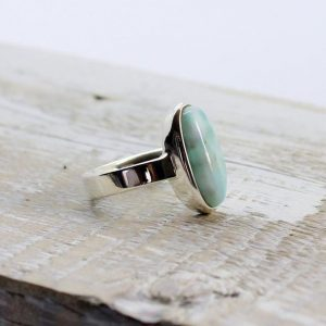 Shop Larimar Rings! Larimar Long Oval Stone Ring Set On A Solid 925e Sterling Silver Mount, Genuine Natural Larimar Stone | Natural genuine Larimar rings, simple unique handcrafted gemstone rings. #rings #jewelry #shopping #gift #handmade #fashion #style #affiliate #ad