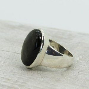 Shop Obsidian Rings! For Men Unisexe Silver Sheen Black Obsidian Ring Oval Shape Natural Obsidian Silver Sheen Set On 925 Sterling Silver Amazing Quality Ring | Natural genuine Obsidian mens fashion rings, simple unique handcrafted gemstone men's rings, gifts for men. Anillos hombre. #rings #jewelry #crystaljewelry #gemstonejewelry #handmadejewelry #affiliate #ad