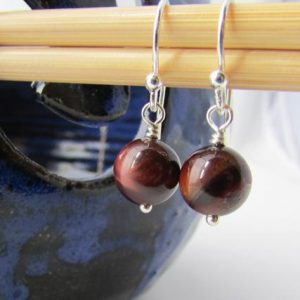 Red Tiger Eye Earrings, small dangle earrings, round tigers eye, tiger iron stone earrings | Natural genuine Tiger Eye earrings. Buy crystal jewelry, handmade handcrafted artisan jewelry for women.  Unique handmade gift ideas. #jewelry #beadedearrings #beadedjewelry #gift #shopping #handmadejewelry #fashion #style #product #earrings #affiliate #ad