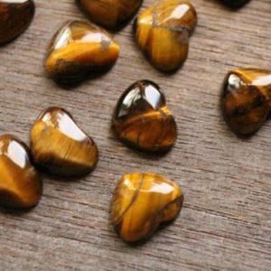 Shop Tiger Eye Shapes! Tiger Eye Small Stone Shaped Heart with Flat Back K268 | Natural genuine stones & crystals in various shapes & sizes. Buy raw cut, tumbled, or polished gemstones for making jewelry or crystal healing energy vibration raising reiki stones. #crystals #gemstones #crystalhealing #crystalsandgemstones #energyhealing #affiliate #ad