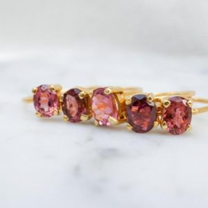 Shop Tourmaline Rings! 6mm pink tourmaline oval cut 14K gold-fill ring. stackable rings. dainty gold gemstone ring dark pink oval gem. dusty rose | Natural genuine Tourmaline rings, simple unique handcrafted gemstone rings. #rings #jewelry #shopping #gift #handmade #fashion #style #affiliate #ad