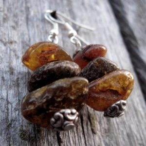 Shop Amber Jewelry! Raw Unpolished Baltic Amber Earrings Dangle Rough Stone Jewelry Natural Eco Earthy Brown Rustic Zen | Natural genuine Amber jewelry. Buy crystal jewelry, handmade handcrafted artisan jewelry for women.  Unique handmade gift ideas. #jewelry #beadedjewelry #beadedjewelry #gift #shopping #handmadejewelry #fashion #style #product #jewelry #affiliate #ad