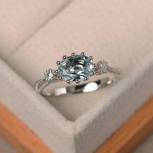 Shop Aquamarine Engagement Rings! Aquamarine engagement ring, sterling silver, oval cut, promise ring for her | Natural genuine Aquamarine rings, simple unique alternative gemstone engagement rings. #rings #jewelry #bridal #wedding #jewelryaccessories #engagementrings #weddingideas #affiliate #ad