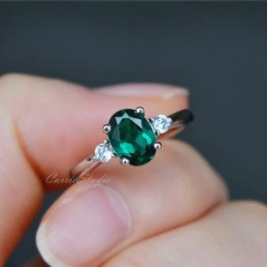 Shop Emerald Engagement Rings! Oval Emerald Engagement Ring/Lab Created Silver Emerald Ring/May Birthstone Ring | Natural genuine Emerald rings, simple unique alternative gemstone engagement rings. #rings #jewelry #bridal #wedding #jewelryaccessories #engagementrings #weddingideas #affiliate #ad