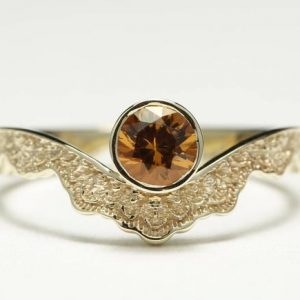 Orange Garnet Engagement Ring, Unique Engagement Ring, Curved Engagement Ring, Spessartite Garnet | Natural genuine Array rings, simple unique alternative gemstone engagement rings. #rings #jewelry #bridal #wedding #jewelryaccessories #engagementrings #weddingideas #affiliate #ad