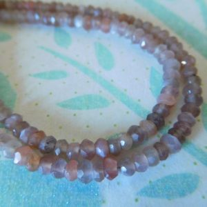 Shop Moonstone Rondelle Beads! Chocolate or Peach MOONSTONE Rondelle Beads – 1/2 Strand, Luxe AAA, 3-4 mm – june birthstone wholesale gemstone beads solo 34 | Natural genuine rondelle Moonstone beads for beading and jewelry making.  #jewelry #beads #beadedjewelry #diyjewelry #jewelrymaking #beadstore #beading #affiliate #ad