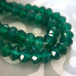 Shop Onyx Faceted Beads! 1/2 Strand, GREEN ONYX Rondelles, Luxe AAA, 3.5-4 mm, Faceted .. may birthstone emerald green spring | Natural genuine faceted Onyx beads for beading and jewelry making.  #jewelry #beads #beadedjewelry #diyjewelry #jewelrymaking #beadstore #beading #affiliate #ad
