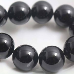 Shop Onyx Round Beads! 16mm Natural Black Onyx Beads, natural Smooth And Round Beads, 15 Inches One Starand | Natural genuine round Onyx beads for beading and jewelry making.  #jewelry #beads #beadedjewelry #diyjewelry #jewelrymaking #beadstore #beading #affiliate #ad
