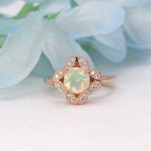 Shop Opal Rings! Genuine Opal Engagement Ring.Diamond Engagement Ring.7mm Diamond Cut Natural Opal & High Quality Diamond .Vintage Style Diamond Wedding Ring | Natural genuine Opal rings, simple unique alternative gemstone engagement rings. #rings #jewelry #bridal #wedding #jewelryaccessories #engagementrings #weddingideas #affiliate #ad