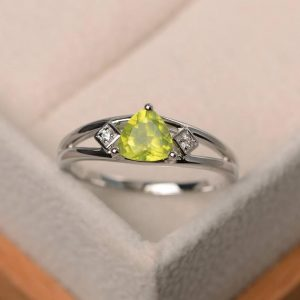 Shop Peridot Rings! Natural peridot ring, wedding ring, trillion cut green gemstone, August birthstone, sterling silver ring | Natural genuine Peridot rings, simple unique alternative gemstone engagement rings. #rings #jewelry #bridal #wedding #jewelryaccessories #engagementrings #weddingideas #affiliate #ad