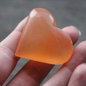 Shop Selenite Shapes! Selenite Orange Medium Heart SL17 | Natural genuine stones & crystals in various shapes & sizes. Buy raw cut, tumbled, or polished gemstones for making jewelry or crystal healing energy vibration raising reiki stones. #crystals #gemstones #crystalhealing #crystalsandgemstones #energyhealing #affiliate #ad