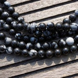 Shop Snowflake Obsidian Beads! Snowflake Obsidian 7-8mm round beads  (ETB00152) | Natural genuine beads Snowflake Obsidian beads for beading and jewelry making.  #jewelry #beads #beadedjewelry #diyjewelry #jewelrymaking #beadstore #beading #affiliate #ad