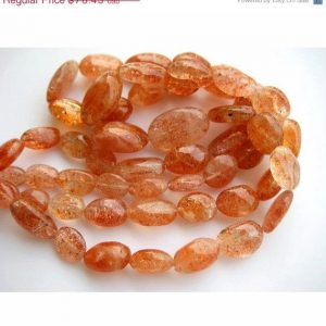 Shop Sunstone Bead Shapes! SunStone Beads, Plain Oval Beads, 8x13mm To 14x20mm Beads, 14 Pieces, 7.5 Inch Strand, Wholesale Price | Natural genuine other-shape Sunstone beads for beading and jewelry making.  #jewelry #beads #beadedjewelry #diyjewelry #jewelrymaking #beadstore #beading #affiliate #ad