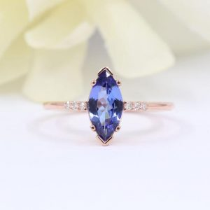 Shop Tanzanite Rings! Natural Tanzanite Engagement Ring.Tanzanite Solitaire Wedding Ring.Bridal Ring.14K Solid Gold.Diamond Ring.Marquise Tanzanite Ring. | Natural genuine Tanzanite rings, simple unique alternative gemstone engagement rings. #rings #jewelry #bridal #wedding #jewelryaccessories #engagementrings #weddingideas #affiliate #ad