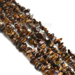 Shop Tiger Eye Chip & Nugget Beads! Stone Chips, Gemstone Chip Beads, Yellow Tiger Eye Chip Beads, One Full Strand Chips for DIY Jewelry Making | Natural genuine chip Tiger Eye beads for beading and jewelry making.  #jewelry #beads #beadedjewelry #diyjewelry #jewelrymaking #beadstore #beading #affiliate #ad