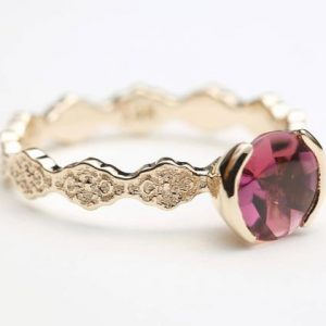 Shop Tourmaline Rings! Pink Tourmaline Engagement Ring, Unique Engagement Ring, Rose Gold Engagement Ring, Solitaire Engagement Ring, Tourmaline Engagement Ring | Natural genuine Tourmaline rings, simple unique alternative gemstone engagement rings. #rings #jewelry #bridal #wedding #jewelryaccessories #engagementrings #weddingideas #affiliate #ad