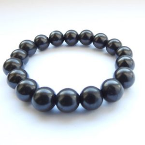 Shop Shungite Bracelets! 10mm Natural Shungite Bead Stretchy Bracelet 19cm | Natural genuine Shungite bracelets. Buy crystal jewelry, handmade handcrafted artisan jewelry for women.  Unique handmade gift ideas. #jewelry #beadedbracelets #beadedjewelry #gift #shopping #handmadejewelry #fashion #style #product #bracelets #affiliate #ad