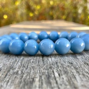 Shop Angelite Jewelry! Chunky Angelite Beaded Bracelet 12mm Anhydrite Beaded Gemstone Bracelet Blue Stack Bracele Gift Bracelet Protection And Healing Bracelet | Natural genuine Angelite jewelry. Buy crystal jewelry, handmade handcrafted artisan jewelry for women.  Unique handmade gift ideas. #jewelry #beadedjewelry #beadedjewelry #gift #shopping #handmadejewelry #fashion #style #product #jewelry #affiliate #ad