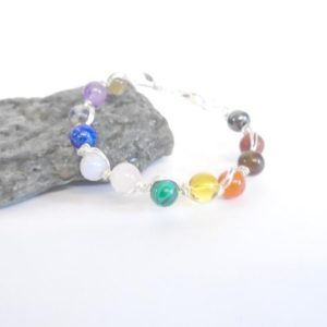 Shop Chakra Bracelets! Chakra Stone Bracelet, Chakra Jewelry, Gemstone Healing Bracelet, 7 Chakra Bracelet Bangle, Rainbow Bracelet, Wire Wrapped Jewelry Gift | Shop jewelry making and beading supplies, tools & findings for DIY jewelry making and crafts. #jewelrymaking #diyjewelry #jewelrycrafts #jewelrysupplies #beading #affiliate #ad