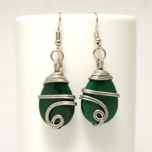 Shop Emerald Earrings! Silver Wire Wrapped Emerald Dangle Earrings, Tear Drop Emerald Earrings | Natural genuine Emerald earrings. Buy crystal jewelry, handmade handcrafted artisan jewelry for women.  Unique handmade gift ideas. #jewelry #beadedearrings #beadedjewelry #gift #shopping #handmadejewelry #fashion #style #product #earrings #affiliate #ad