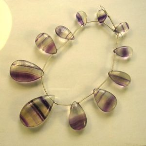 Shop Fluorite Bead Shapes! Banded Purple Fluorite Smooth Pear Beads Aaa 13-37mm 11 Pieces | Natural genuine other-shape Fluorite beads for beading and jewelry making.  #jewelry #beads #beadedjewelry #diyjewelry #jewelrymaking #beadstore #beading #affiliate #ad