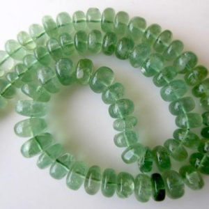Shop Fluorite Rondelle Beads! Huge Fluorite Rondelle Beads, Smooth Green Fluorite Beads, 6-12mm Each, 17 Inch Strand, Gds608 | Natural genuine rondelle Fluorite beads for beading and jewelry making.  #jewelry #beads #beadedjewelry #diyjewelry #jewelrymaking #beadstore #beading #affiliate #ad