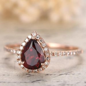 Shop Garnet Rings! 1ct VS Natural Red Garnet Engagement Ring 14K Rose Gold Diamond Wedding Band 5x7mm Pear Shaped Garnet Ring Diamond HALO Bridal Ring | Natural genuine Garnet rings, simple unique alternative gemstone engagement rings. #rings #jewelry #bridal #wedding #jewelryaccessories #engagementrings #weddingideas #affiliate #ad